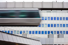 Sky-Train passing fast in front of office building Royalty Free Stock Photography