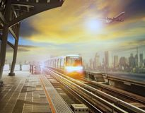 Sky trains mass transportation station and plane flying over cit Royalty Free Stock Images