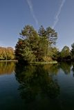 Sky, Tree, Water. Lake in the Central Park of Cluj Napoca Stock Photo
