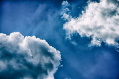 Sky. And two clouds, light white and dark black in opposite corners of the image Royalty Free Stock Photo