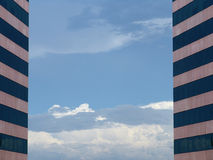 Sky between two identical buildings Royalty Free Stock Images