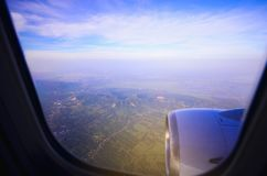 Sky view from airplane. Aerial view from windows. Royalty Free Stock Photos