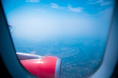 Sky view from airplane. Aerial view from windows. Transportation Concept Royalty Free Stock Photo