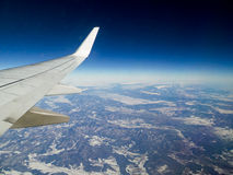Sky view from airplane window Stock Photos