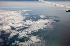 Sky view from airplane window Royalty Free Stock Photos