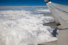 Sky view from airplane window Stock Images
