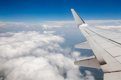 Sky view from airplane window. Blue sky view from the airplane window Royalty Free Stock Photo