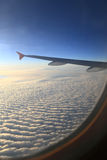 Sky view of airplanes window clouds Stock Image