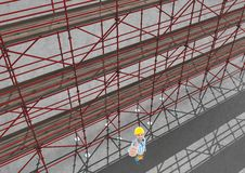 Sky view of 3D scaffolding beside happy builder raising his hand. Digital composite of Sky view of 3D scaffolding beside happy builder raising his hand Royalty Free Stock Images