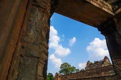 Sky view looking through the door of Bayon Temple at Angkor Thom. stock photos