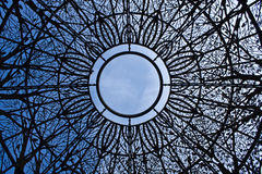 Sky View Through Ornamental Dome. Ornamental Iron Dome at The Sunken Gardens in Lincoln, NE Royalty Free Stock Photo