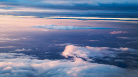 Sky view from a plane. Sky and clouds image taken form above while flying in a plane Stock Photo