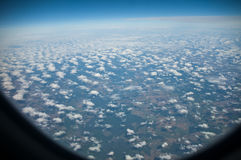 Sky view on the plane window. Blue and Cloudy Sky view on the plane window Royalty Free Stock Images