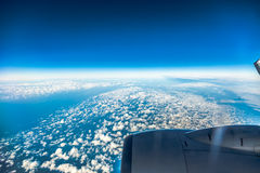 Sky. View from window of airplane flying in clouds Stock Images