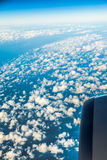 Sky. View from window of airplane flying in clouds Stock Image