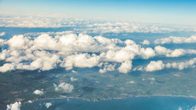 Sky. View from window of airplane flying in clouds Stock Photo