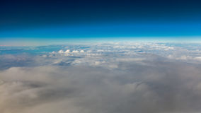 Sky. View from window of airplane flying in clouds Royalty Free Stock Photos