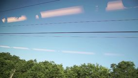 Sky view from a window running train stock video footage