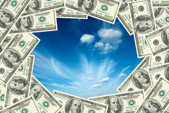Sky visible through frame. Made of hundred dollars banknotes Royalty Free Stock Image