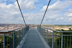 Sky walk observation deck at opencast mining in Garzweiler. View point at opencast mining in Garzweiler, Germany. A skywalk over the open pit where you can watch royalty free stock photography