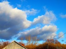 Sky. The sky was azure blue colour: it was white and fluffy, like lambs of the cloud Royalty Free Stock Photography