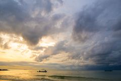 The sky was storm at the beach at sunrise. Stock Photos