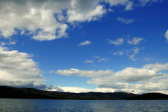 Sky and water 01. Blue sky and dark water Royalty Free Stock Photos