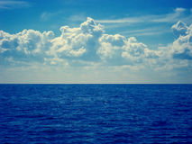 Sky and water. Photo about blue sky, waves and white clouds stock photography