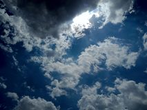 Sky with water clouds and sunlight. stock photos