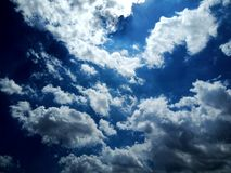 Sky with water clouds and sunlight. stock image