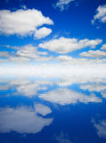 Sky and water reflection. Blue sky and water reflection Royalty Free Stock Images