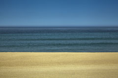 Sky, water and sand. A view of an empty beach Royalty Free Stock Photography