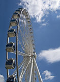 Sky Wheel. Ferris wheel located in an amusement park, seen in vertical format Stock Photos