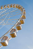 Sky wheel. Running ferris with good view under blue sky. Winter, France Royalty Free Stock Photos