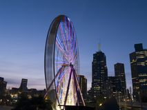SKy Wheel. The sky wheel at dusk with a backdrop of Melbourne City Royalty Free Stock Photos