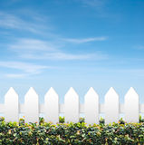 Sky and white fences. White and green fences shot against blue sky Royalty Free Stock Images