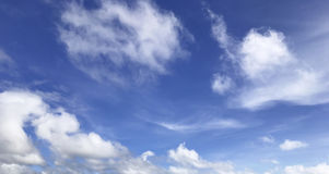 Sky. White fluffy clouds in the blue sky background Stock Image