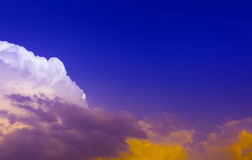 Sky. White and yellow bright light on clouds in dark blue sky Royalty Free Stock Photography