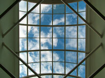 Sky from window in modern centre Stock Photo