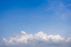 Sky with wispy cumulus clouds. Fluffy cumulus clouds on the blue sky royalty free stock photo