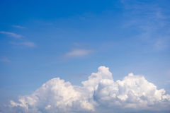 Sky with wispy cumulus clouds. Fluffy cumulus clouds on the blue sky royalty free stock images