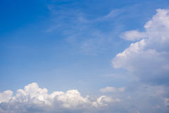 Sky with wispy cumulus clouds. Fluffy cumulus clouds on the blue sky stock image