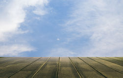 Sky and wood floor background Stock Photos