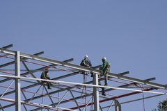 Sky Workers. High rise building construction workers Stock Photo
