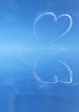 Sky writing heart over water Royalty Free Stock Photo