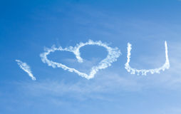 I Love You Written in the Sky. The phrase I Love You with the symbol of a heart written in the sky with white smoke by a sky writer Stock Photo