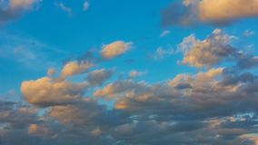 Sky and yellow clouds at sundown. Day to night timelapse stock video