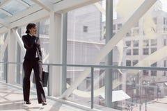 Skybridge Businesswoman - Horizontal Stock Photo