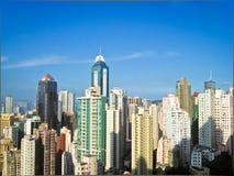 Skycrapers在有太阳的2香港 免版税库存照片