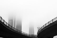 Skycrapers in the mist. Stock Photos